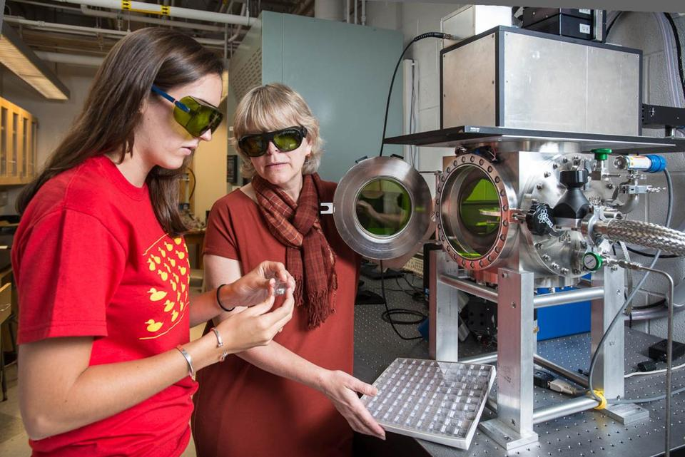 Alumna Erica Jawin (left) and astronomy professor Darby Dyar at work in a Mount Holyoke College laboratory.