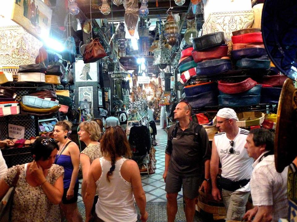 All kinds of goods are piled high in a Marrakech souk.