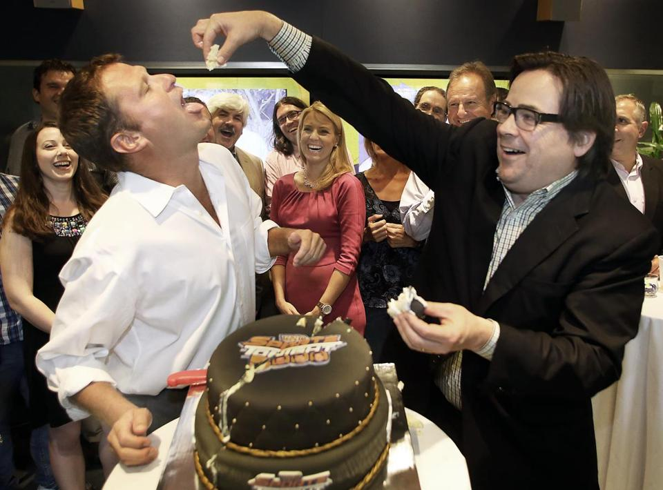8-13-2012 Burlington, Mass. 100 guests atttended a Comcast Sportsnet Uno's Sports to Celebrate Milestone 5,000th Episode on Monday 13th in their Burlington Studios. cuting the cake are Comcast hosts Michael Felger and Gary Tanguay. Globe photo by Bill Brett