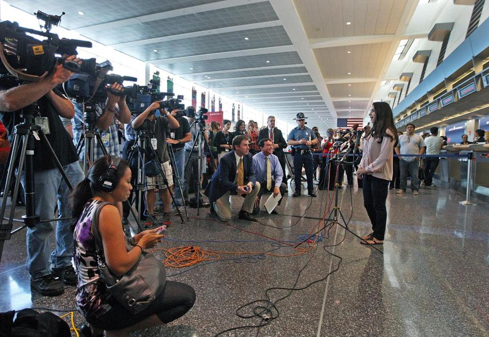 Aly Raisman addressed reporters at Logan International Airport after her arrival Wednesday afternoon.