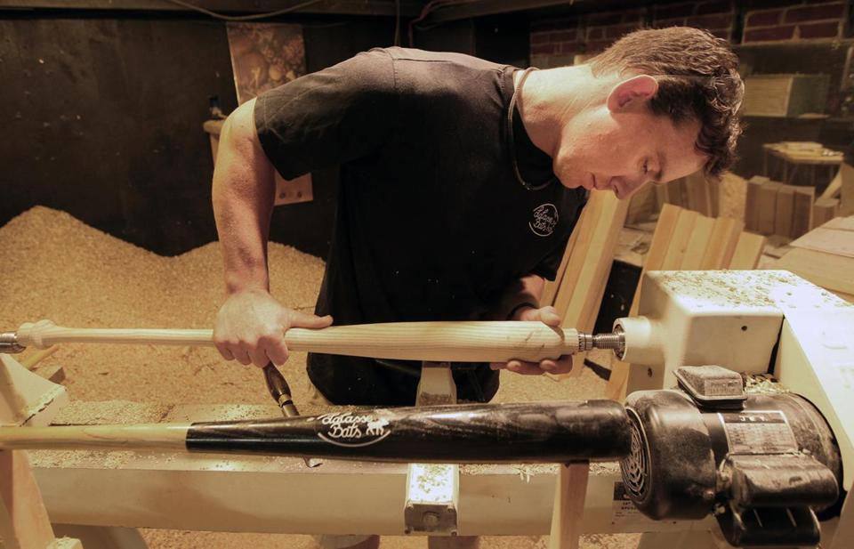 Jesse LaCasse, owner of LaCasse Bats, turns trees into baseball bats at his Maine workshop.
