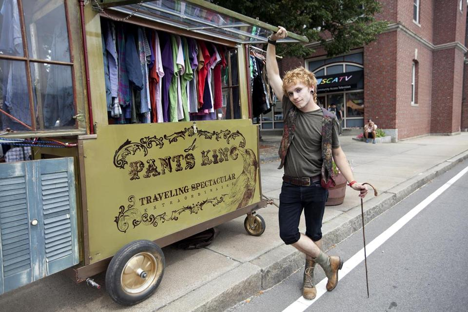 Justin Pomerleau with his traveling clothing shop in Somerville's Union Square.