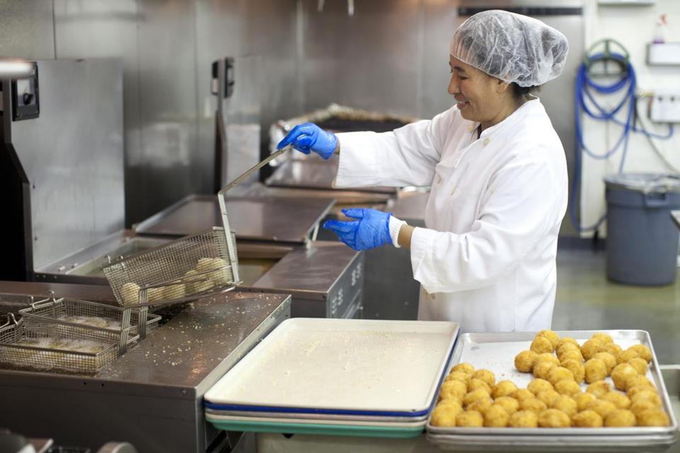 Ngawng Sangmo fried arancini balls in canola oil at the Whole Foods facilty in Everett, which uses a new system of recycling oil.