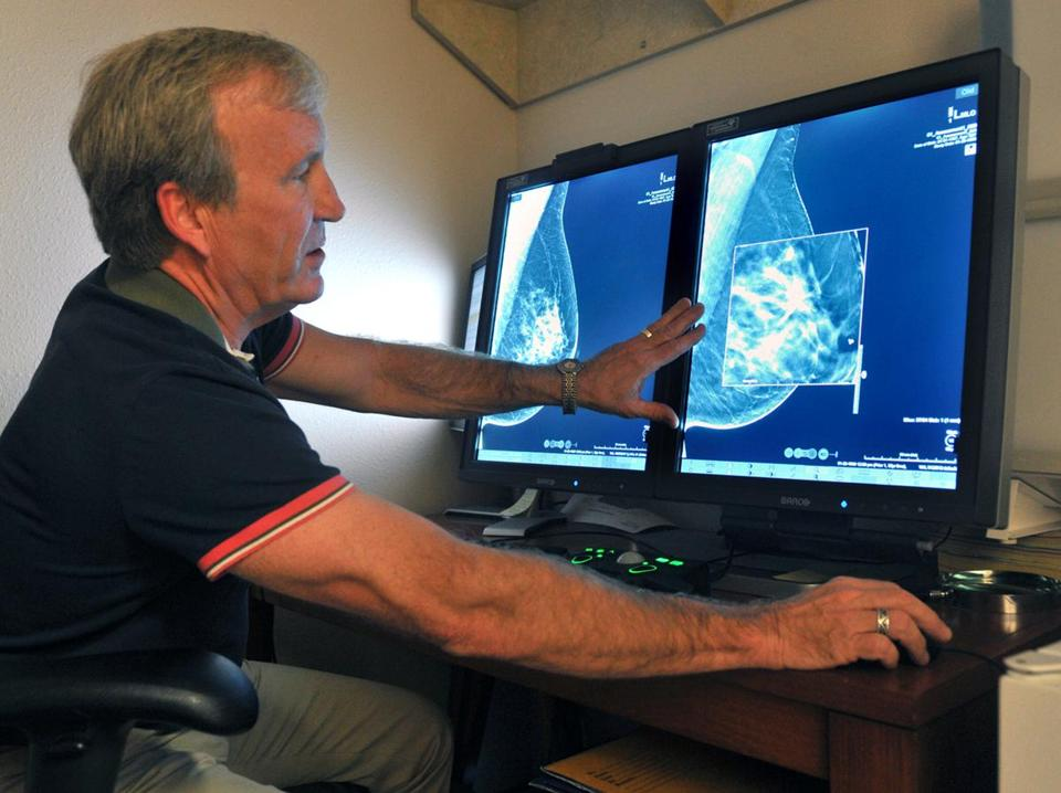 Radiologist Dr. Paul Bice compared an image from earlier, 2-D technology mammogram to the new 3-D Digital Breast Tomosynthesis mammography in Wichita Falls, Texas, in 2012.