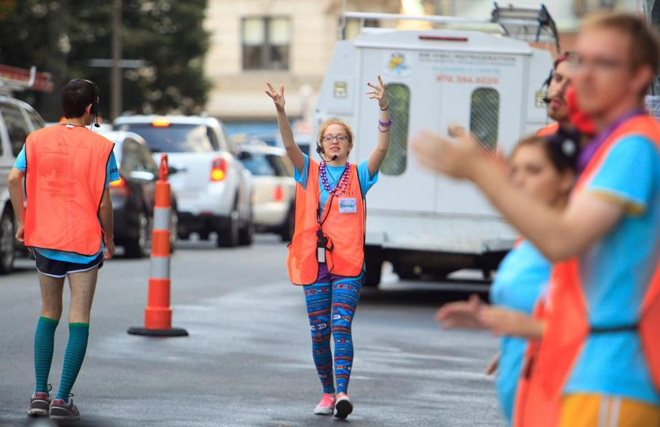 Emerson sophomore Hannah Kole directed cars on move-in day in Boston.