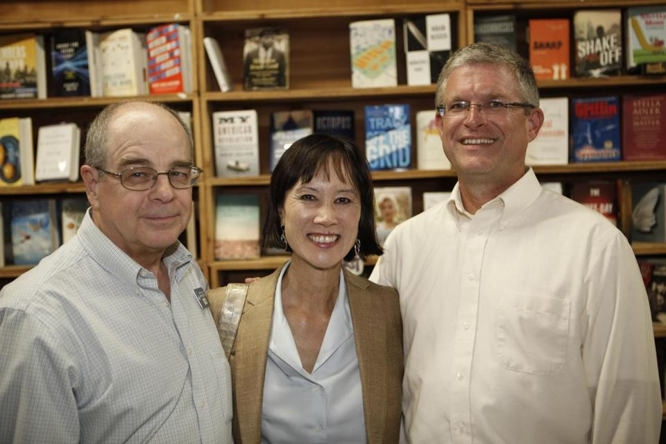 "Bestselling Author of ""Rizzoli & Isles"", Tess Gerritsen (center) poses with owner, Tom Lyons (left) and Events Manager, Dave Ambler (right) at the New England Book Fair/"