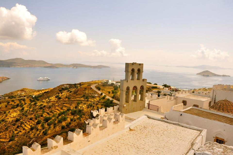 The Holy Monastery of St. John the Divine, which has this rooftop view of Patmos, Greece.