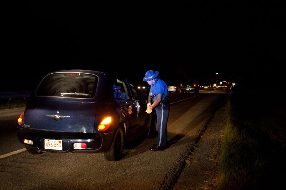 A Massachusetts State Trooper talks to a driver he pulled over on Route 24 last August.