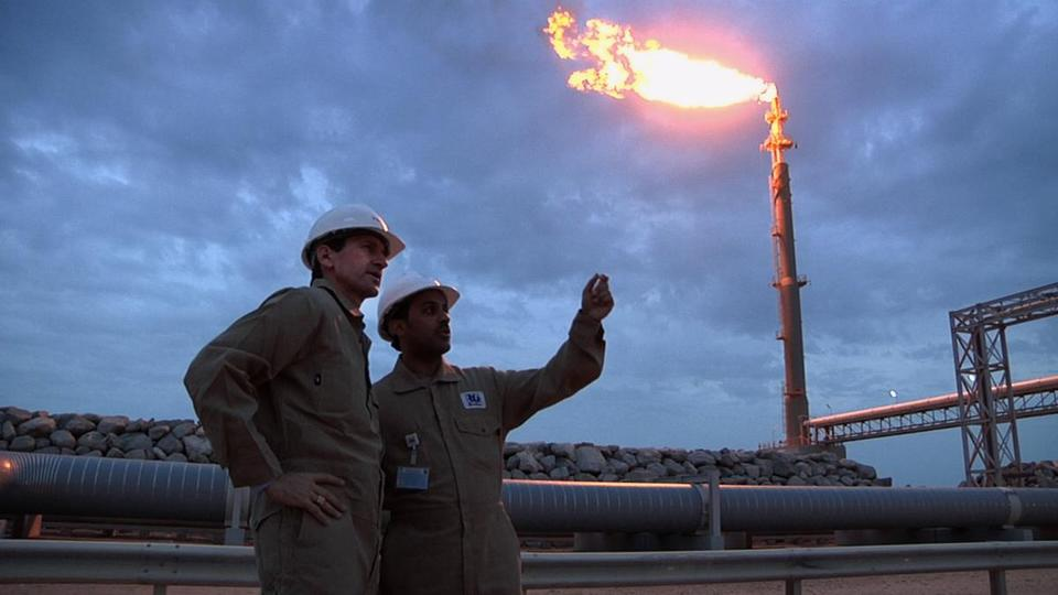 "Dr. Scott Tinker (left) and marine engineer Talal al Tamimi, on an LNG fueling dock in Qatar in the documentary ""Switch."""