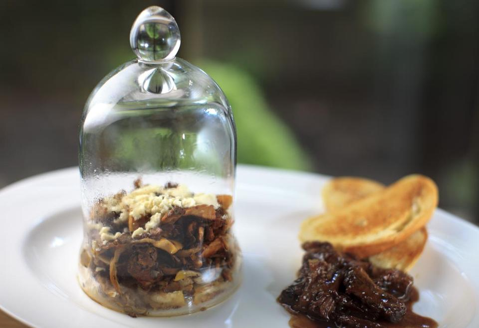 """Under glass,"" an appetizer (circa 1903) of mushrooms and cheese, oxtail and brioche toast."