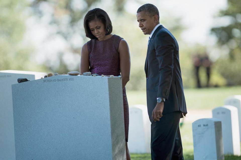 President Barack Obama and first lady Michelle Obama visited a mass grave for those who died on October 26, 2009 in a helicopter crash while serving in Afghanistan at Arlington National Cemetery's Section 60 in September 2012.