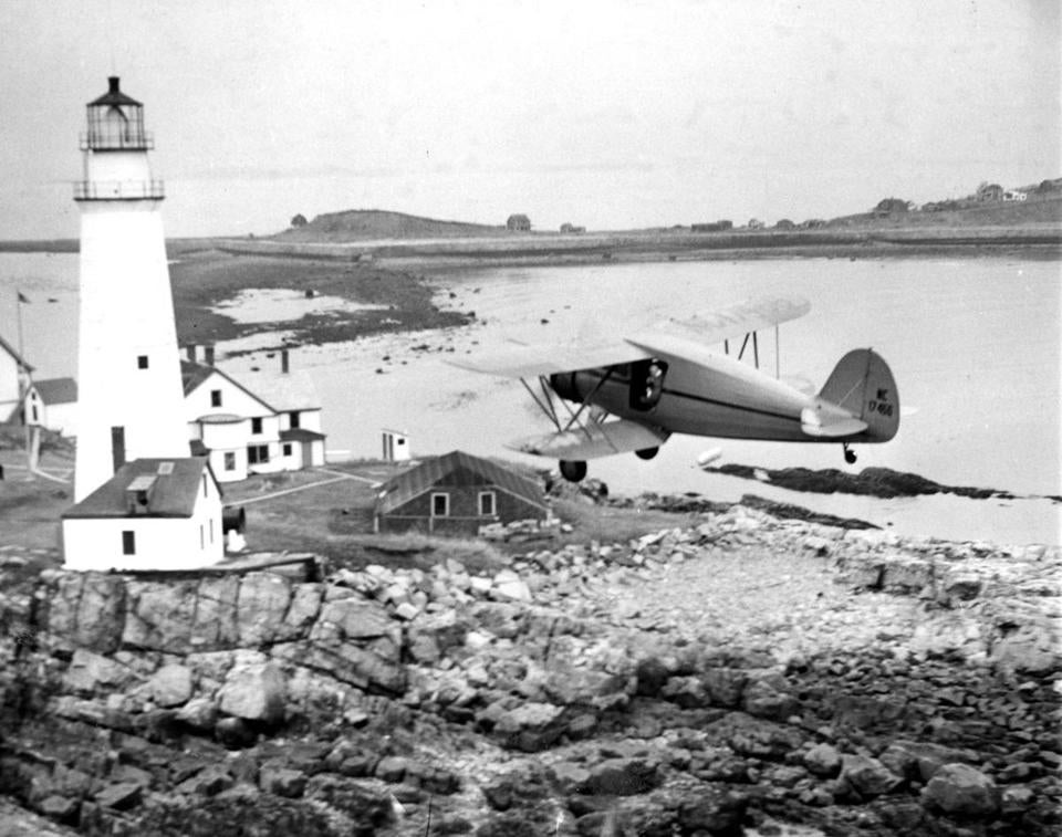 A 1940 photo from the Friends of Flying Santa archives has Edward Rowe Snow dropping off a bundle at Boston Light.