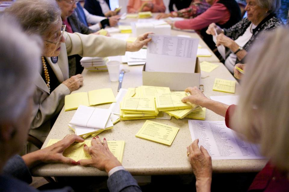 On a recent Sunday morning, members of Brookhaven at Lexington's chapter of Grandmothers for Obama bundle cards to be sent to voters in swing states.