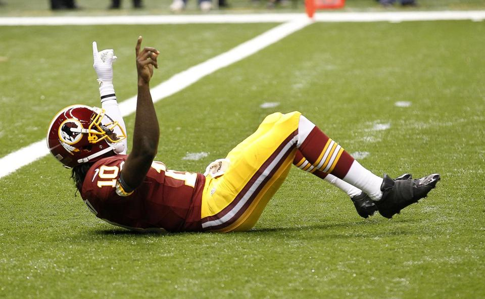 Redskins quarterback Robert Griffin III completed 19 of 26 passes (73.1 percent) for 320 yards and two touchdowns, for a quarterback rating of 139.9.