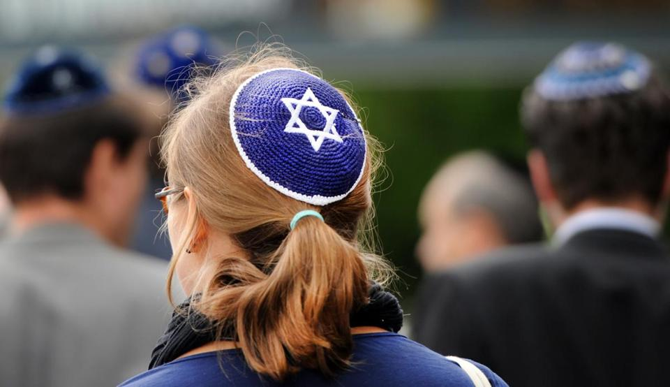 A woman wears a kippah, the traditional Jewish headgear, as she takes part in a demonstration on September 15, 2012 in front of the Cathedral in Berlin. People were invited via an internet call for the so-called Kippah-Stroll to point out a sign against anti-Semitism ahead of the upcoming Rosh Hashanah Jewish New Year's festival. AFP PHOTO / BRITTA PEDERSEN GERMANY OUTBRITTA PEDERSEN/AFP/GettyImages