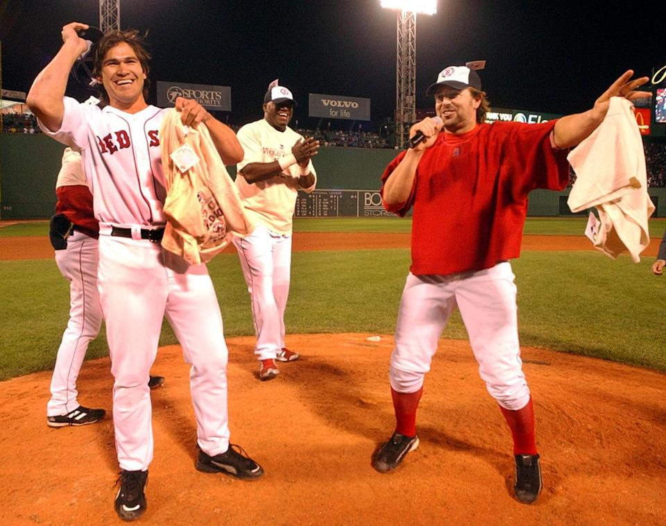 Johnny Damon, David Ortiz, and Kevin Millar, left to right, celebrated with the Fenway Park crowd after the clinching win.