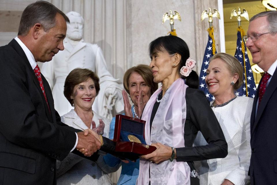 Aung San Suu Kyi received the Congressional Gold Medal from House Speaker John Boehner, with Laura Bush, Nancy Pelosi, Hillary Clinton, and Mitch McConnell.