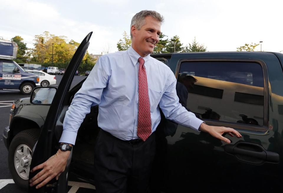 Senator Scott Brown arrives for the debate.