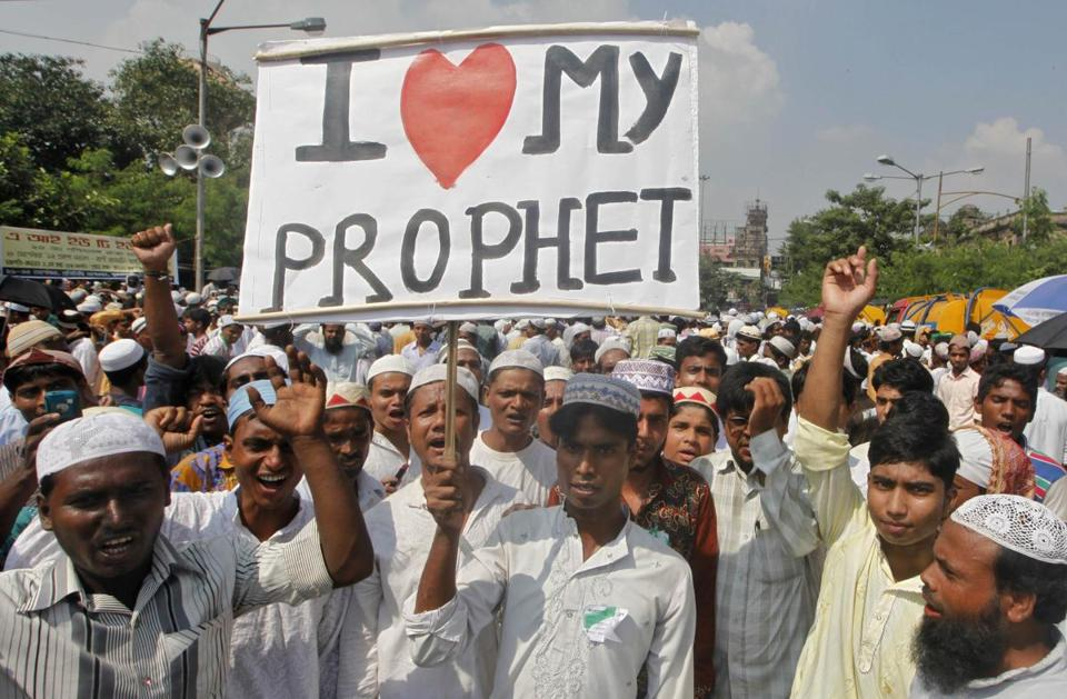 A Muslim man in Calcutta held up a placard during a protest against a film considered to be blasphemous.