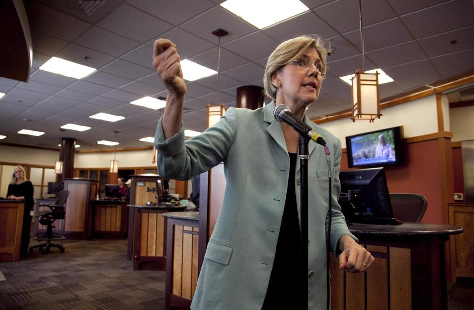 Elizabeth Warren responded to questions form reporters at Liberty Bay Credit Union headquarters in Braintree Wednesday.