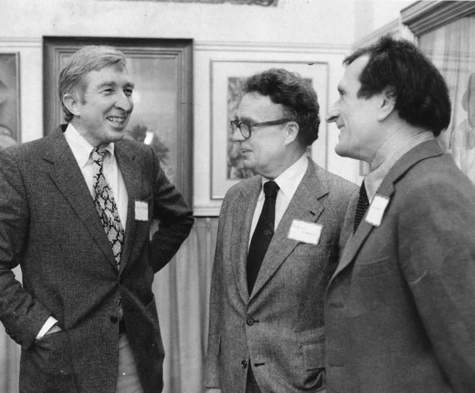 Robert Manning (center) with John Updike and biographer Justin Kaplan in 1979.