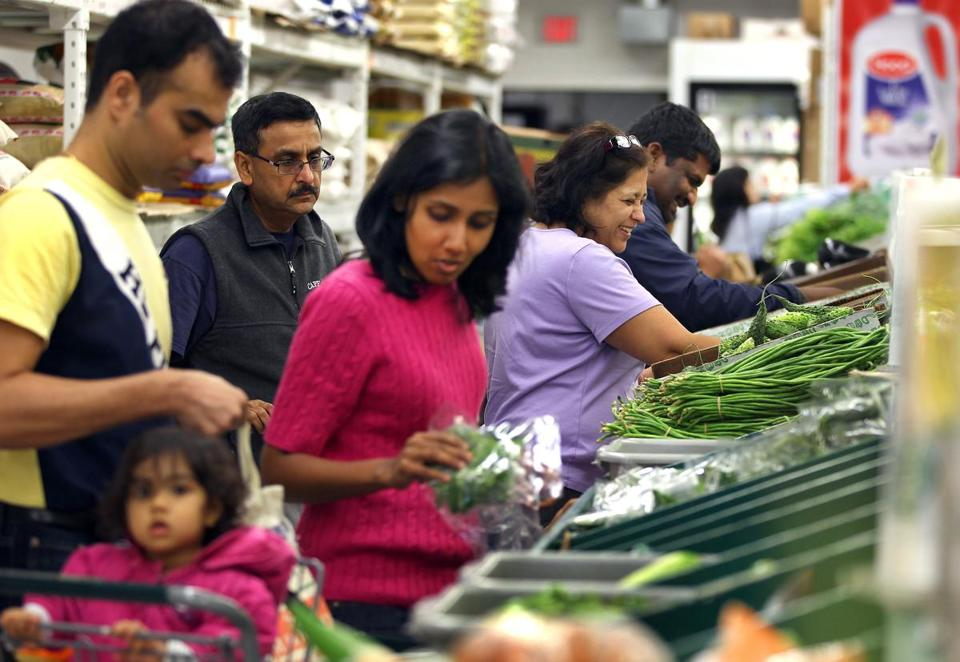 In Shrewsbury, shoppers examine the fresh produce offerings at Patel Brothers, the country's largest Indian grocery store chain.