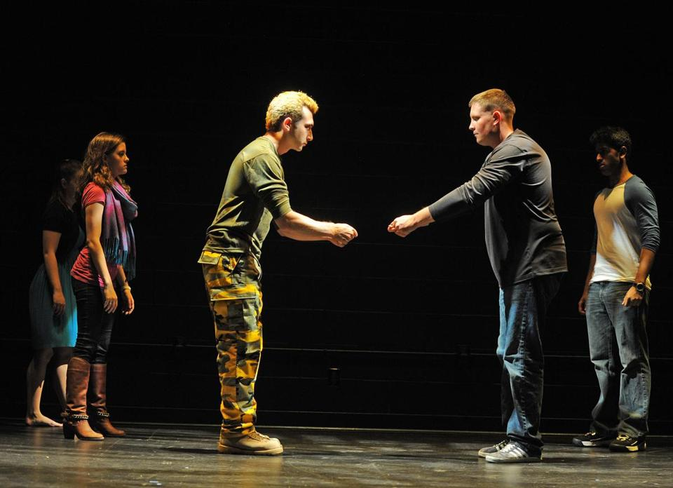"Jim Mihelidakis (left) and Sam Dillon (right) and other students rehearsed the Suffolk University play ""At Ease."""