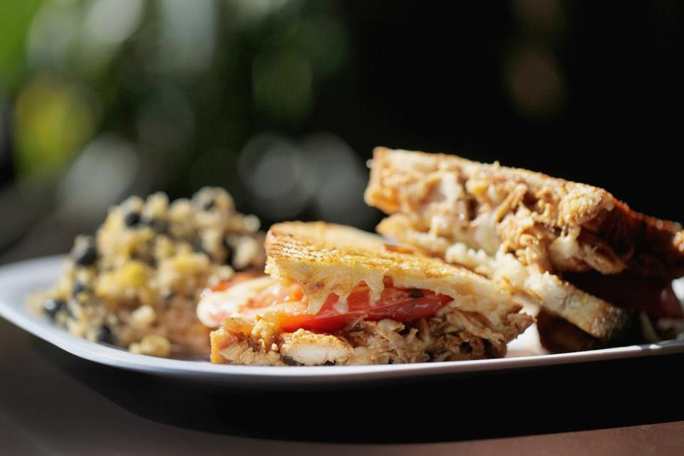 Maximo's barbecued chicken panini, the Perkins, with a side of Southwestern quinoa salad.