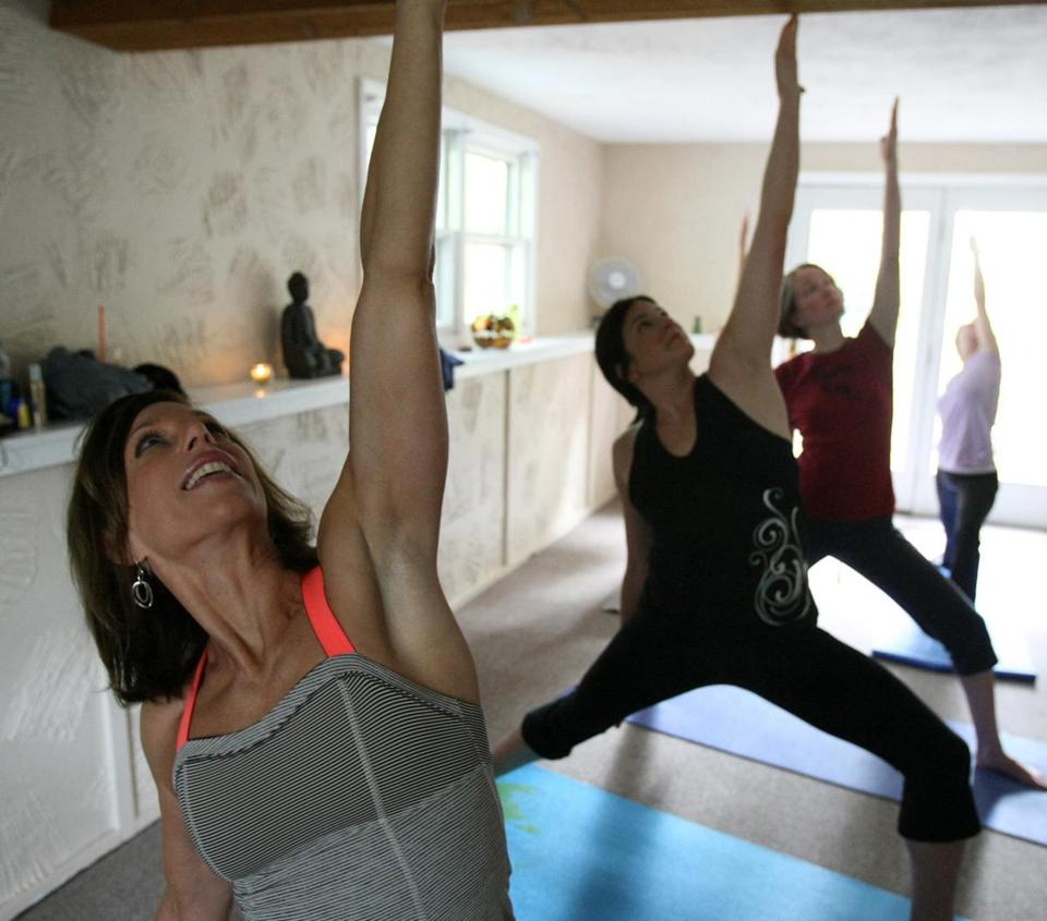 Gail O'Leary led her class through a one-hour vinyasa session at the Norton Parks and Recreation Center.