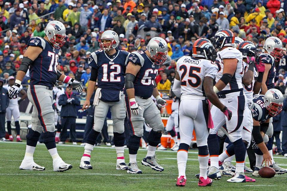 Tom Brady (12) calls out the play — with center Ryan Wendell all ready to roll — as the Patriots' no-huddle offense lines up quickly while the Broncos' defense attempts to adjust.