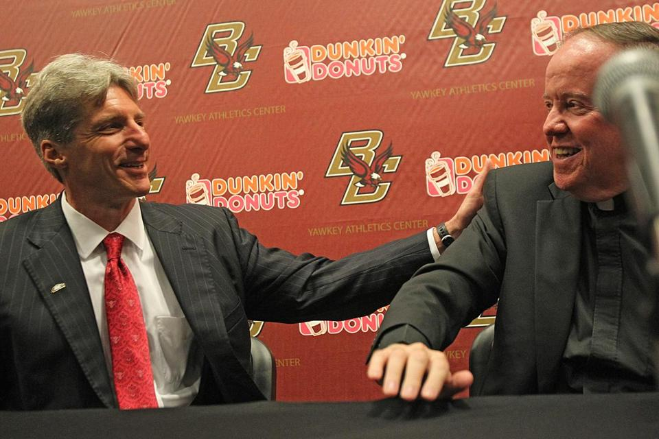 Brad Bates, left, was introduced by Boston College President Fr. William P. Leahy.
