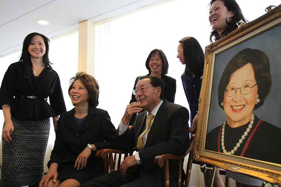 Dr. James Si-Cheng Chao sits next to a portrait of his late wife, Ruth Mulan Chu Chao. Four of their daughters attended Harvard Business School. From left, Angela, Elaine (a former US labor secretary), Christine (who did not attend the school), May, and Grace.