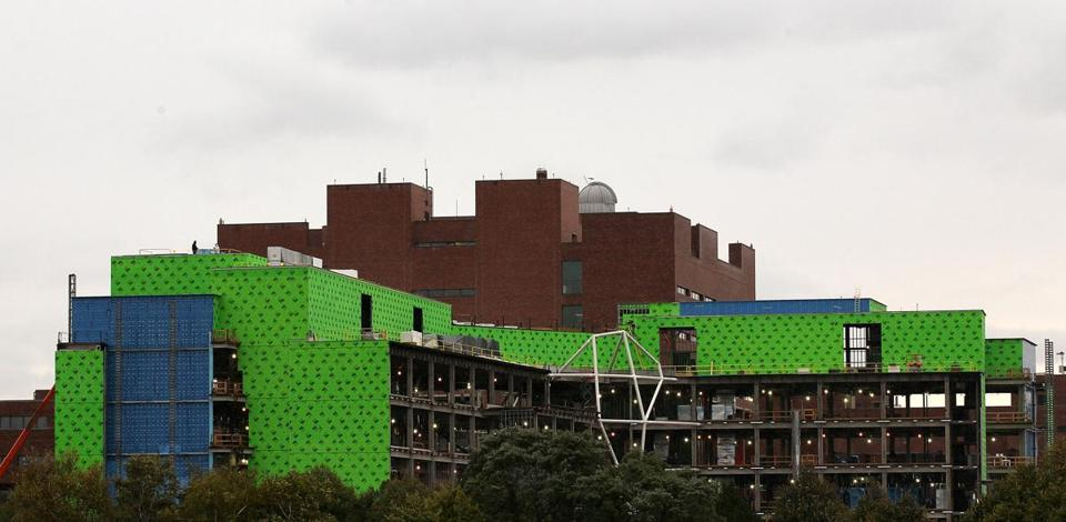 The science complex under construction at UMass Boston is expected to be completed by 2014. The university also plans to add academic buildings and dorm rooms.