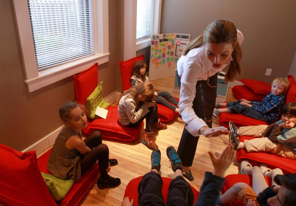 Snezana Pejic, the program director of the Etiquette Academy of New England, high fived children during her class.