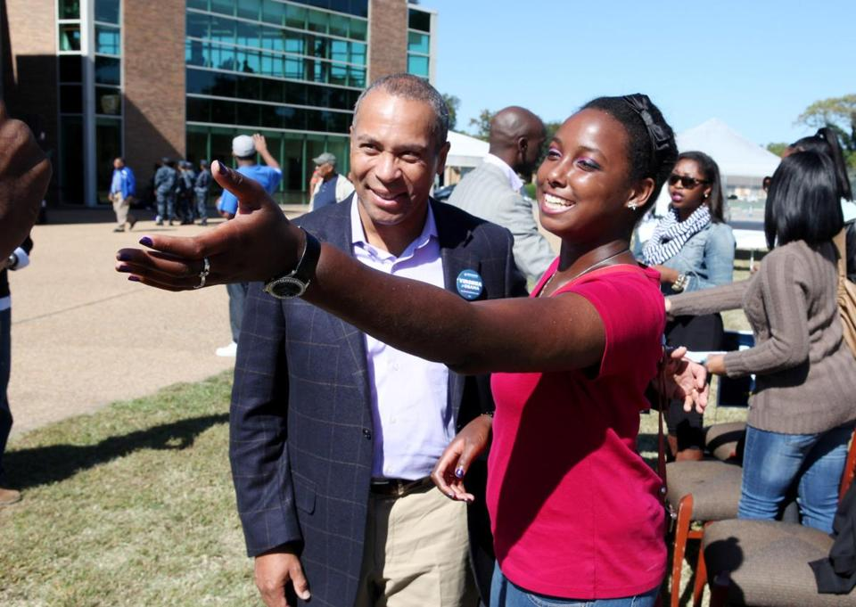 Deval Patrick posed for a picture with Hampton University student Ngozi Alston during the governor's visit to the college in Virginia, where he sought to get the vote out for President Obama.