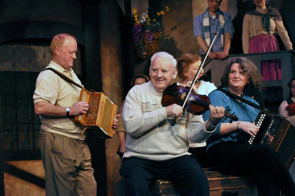 "Larry Reynolds (center), shown performing with Liam Harney of Walpole and Jerry Walker in 2011, was a mainstay of ""A Little Bit of Ireland"" since its inception in 1998."