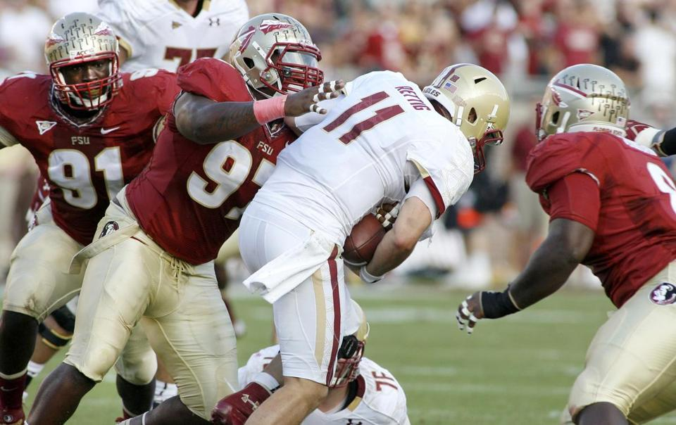 Florida State defensive tackle Demonte McAllister gets his hands on BC quarterback Chase Rettig during the first half of Saturday night's ACC matchup.
