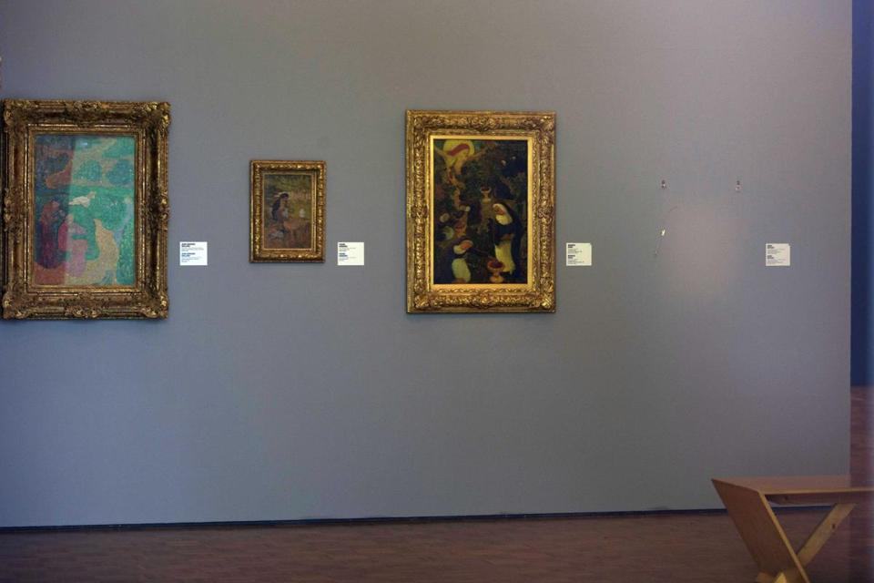 "The empty space where the Matisse painting ""La Liseuse en Blanc et Jaune"" was hanging (right) at Kunsthal museum in Rotterdam, Netherlands."