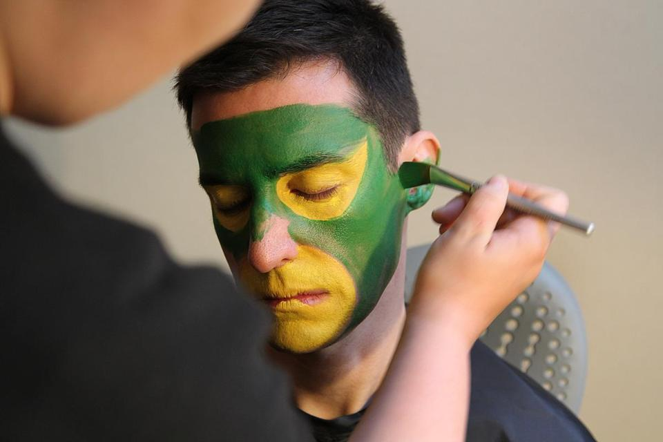 """Landscape green"" makeup was applied to the rest of his face."