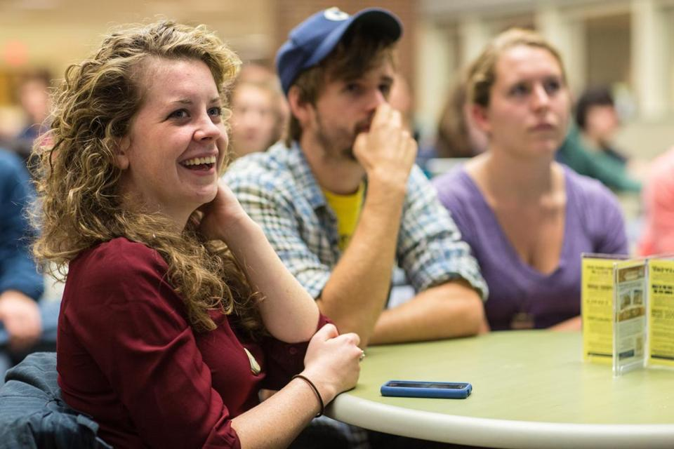 Seniors Mairead Dunphy (above left), Stephen Goodrow, and Jesica Waller were among those who watched the second presidential debate at the University of New Hampshire last month.