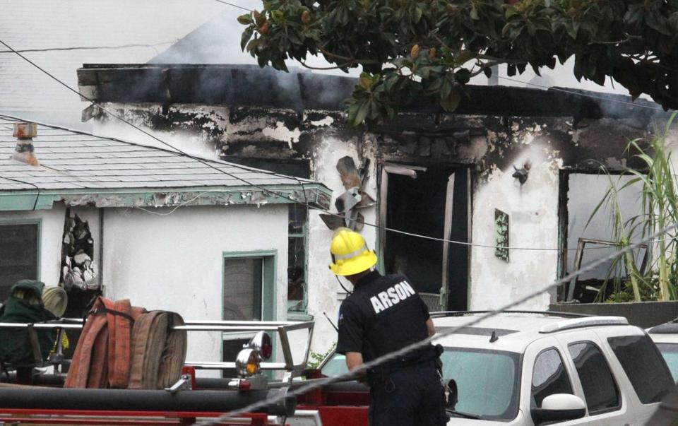 Emergency personnel responded at the scene of a fatal shooting and fire in Inglewood, Calif.