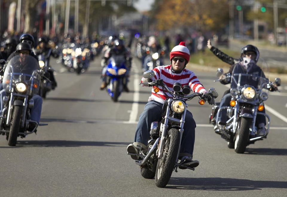 EVERETT, MASSACHUSETTS -- 10/21/2012 -- Bikers take the first turn down Revere Beach Parkway wearing costumes as part of the 24th annual Halloween Witch Ride from Everett to Shetland Park in Salem to benefit the Muscular Dystrophy Association. Brian Feulner for the Boston Globe