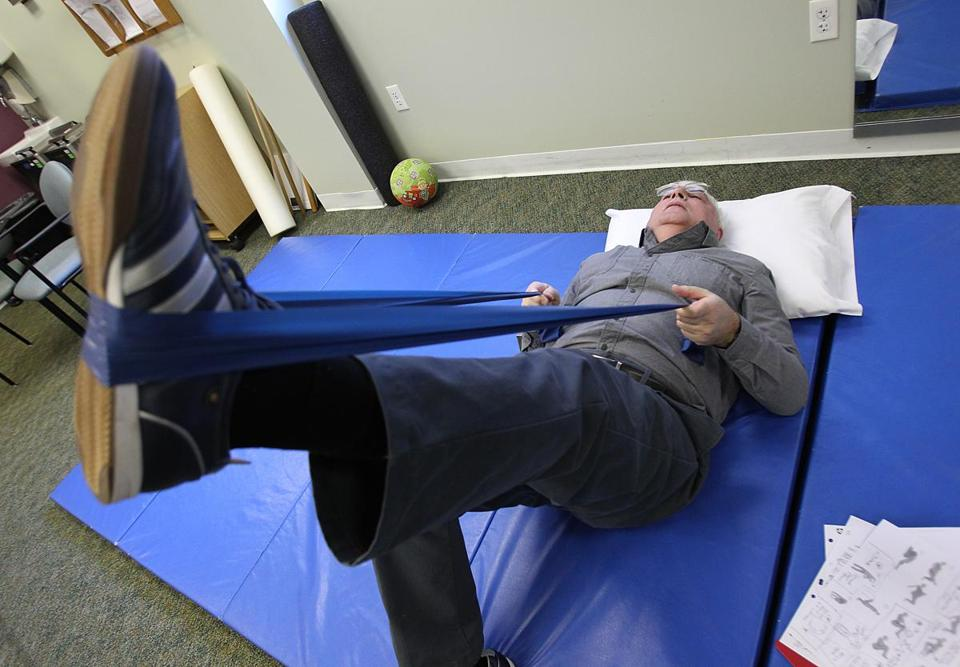 Michael Gershman works out at the Spaulding Outpatient Center in Medford, where back patients participate in education seminars, therapy sessions, and exercise classes.