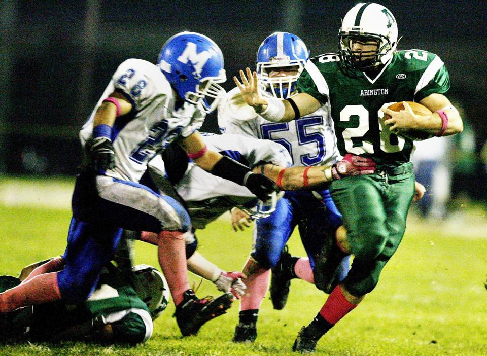 Abington's Matt Kilmain fights off a host of Mashpee defenders during Abington's 34-7 win Saturday.