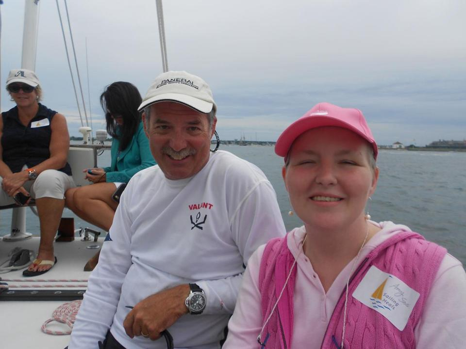 Amy Snow (right), before her death on Oct. 4, sailed with captain Gary Gregory thanks to Sailing Heals, a Haverhill nonprofit that gives cancer patients a trip on the water.