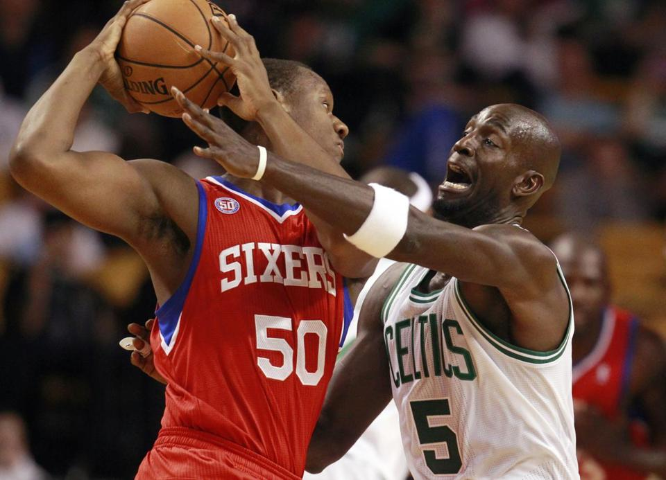 The 76ers' Lavoy Allen has the ball, but Kevin Garnett is within reach during the Celtics' 88-79 exhibition loss.