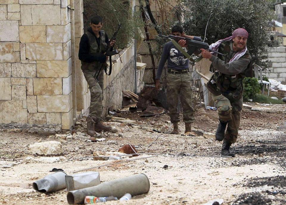 Amember of the Free Syrian Army fired at a sniper while running for cover on Thursday in Harem, Syria.