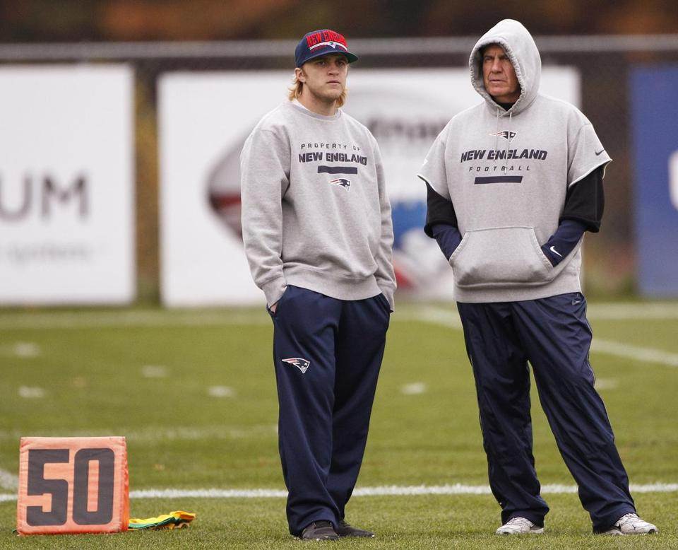 Patriots head coach Bill Belichick, right, talked with his son, coaching assistant Steve Belichick, during practice in Foxborough.
