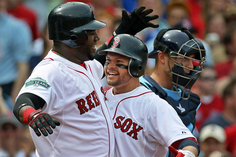 Will both David Ortiz (left) and Cody Ross be back with the Red Sox? One is a little more likely than the other to stay.