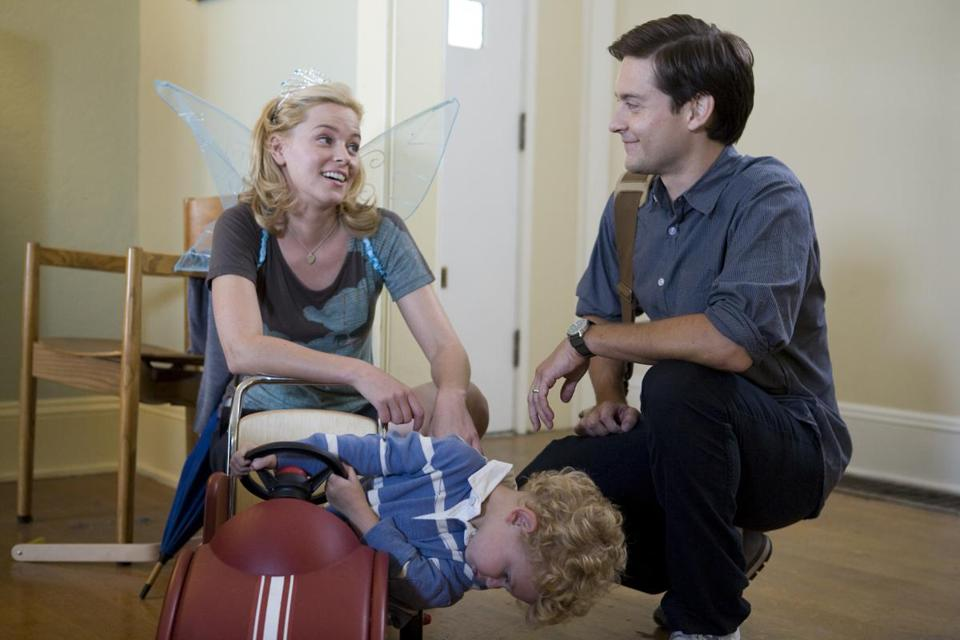 "ELIZABETH BANKS and TOBEY MAGUIRE play a couple with a young son who live in Seattle in ""The Details."""